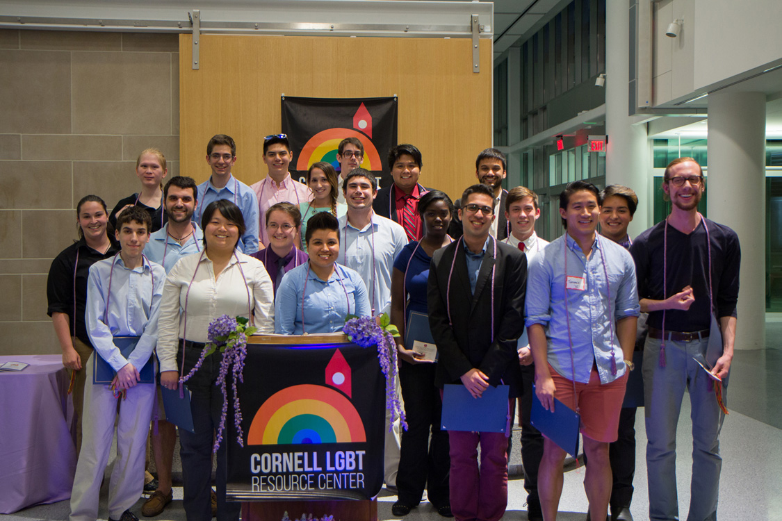 Students with a Cornell LGBT Resource Center banner