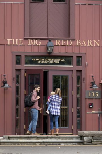 Student family entering Big Red Barn