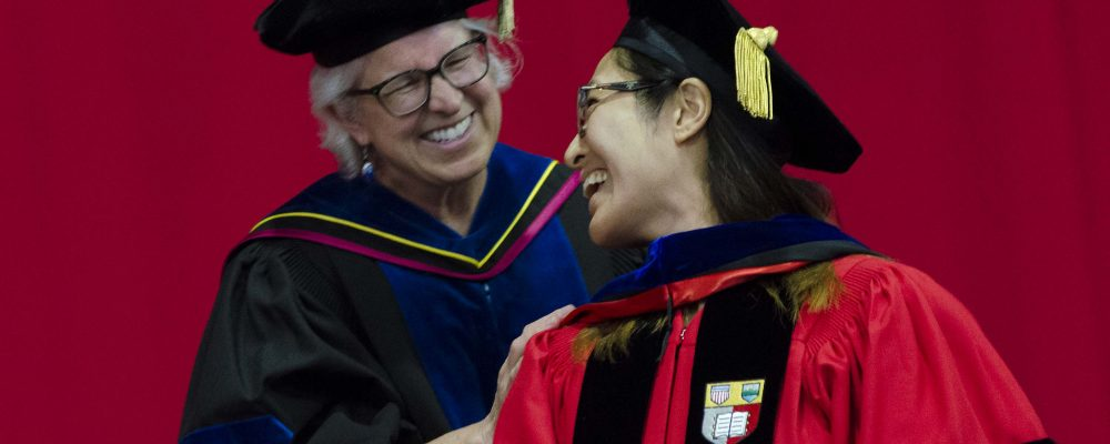 Dean Knuth and a student at the doctoral hooding ceremony