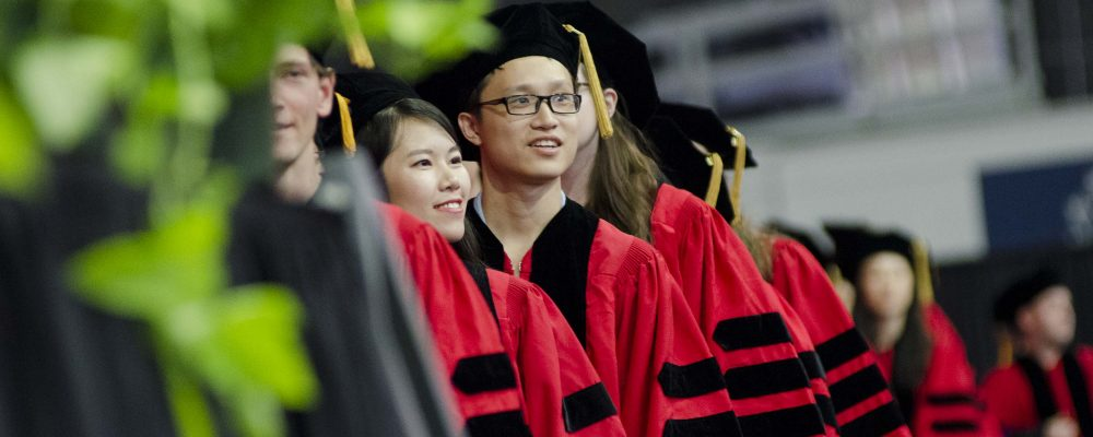 Students participate in the doctoral hooding ceremony