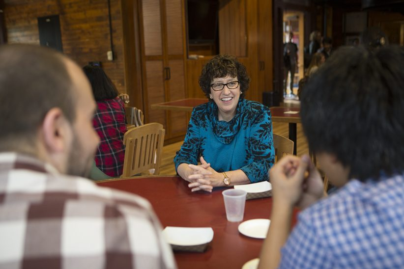 President Martha Pollack and grad students