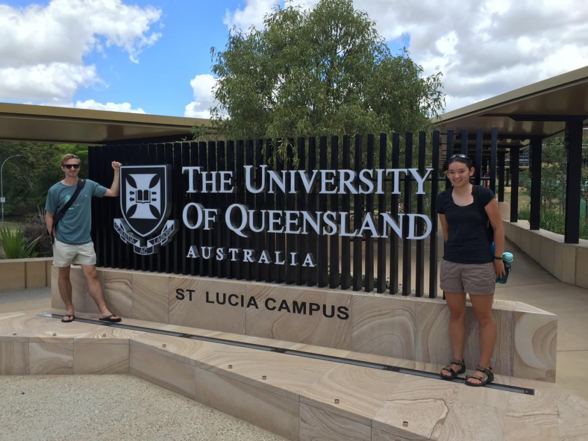 Kalia Bistolas standing in front of the University of Queensland welcome sign in Australia