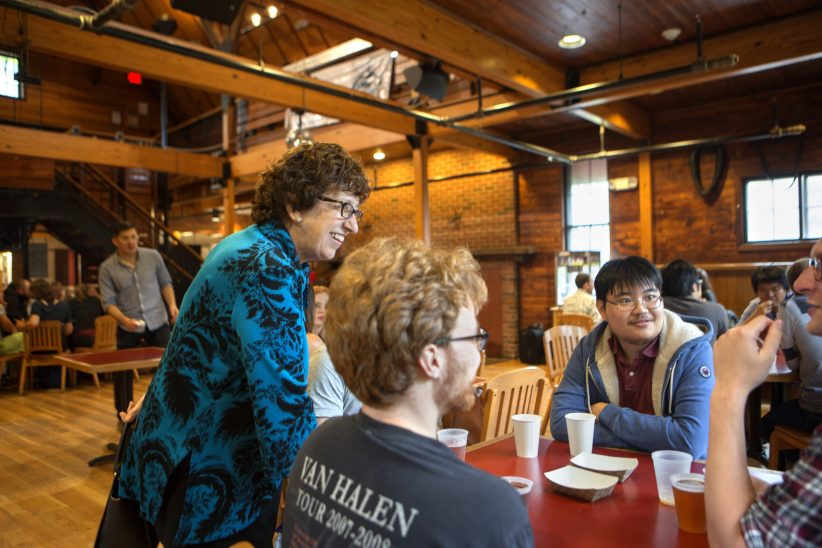 President Martha Pollack speaking with students