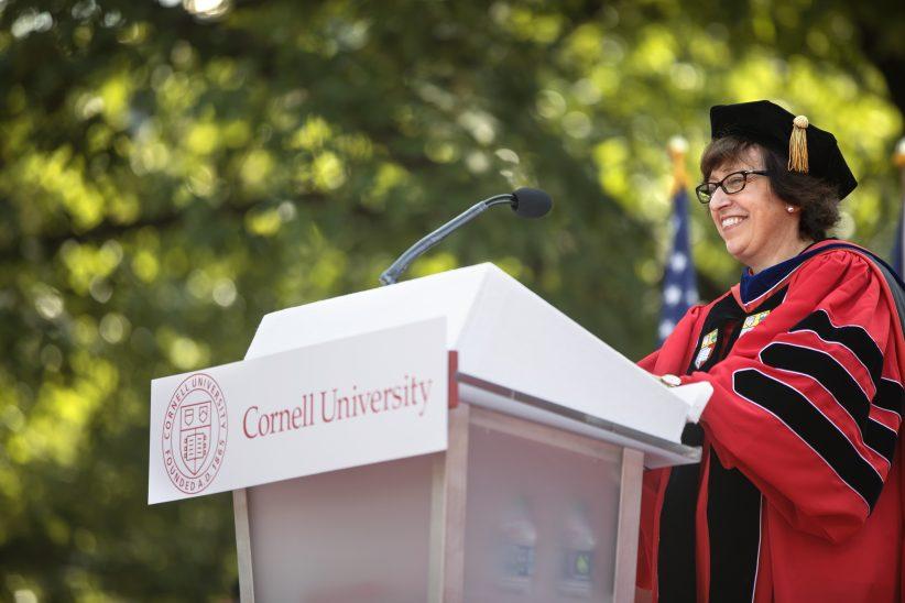 President Martha Pollack behind a podium