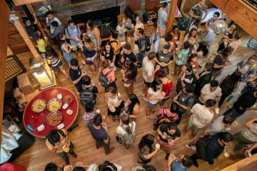 Students enjoy Tell Grads It's Friday (TGIF) at the Big Red Barn