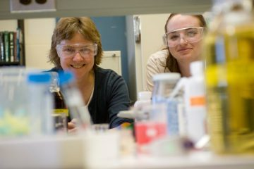 Barbara Baird with students in the lab