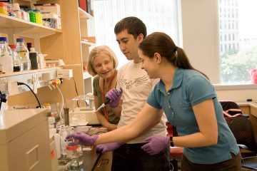 Martha Constantine-Paton with students in MIT lab