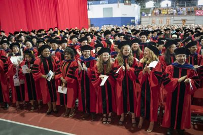 Doctoral candidates at Ph.D. Hooding Ceremony