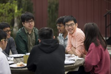 Students at the annual year-end barbecue at the Big Red Barn