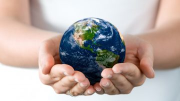 Person holding world in hands