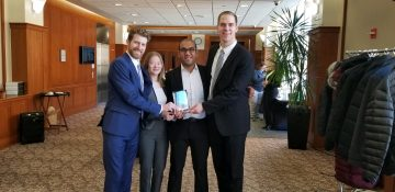 Four MILR students who won the case competition