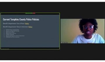Nialah Wilson with a screen listing current Tompkins County police policies