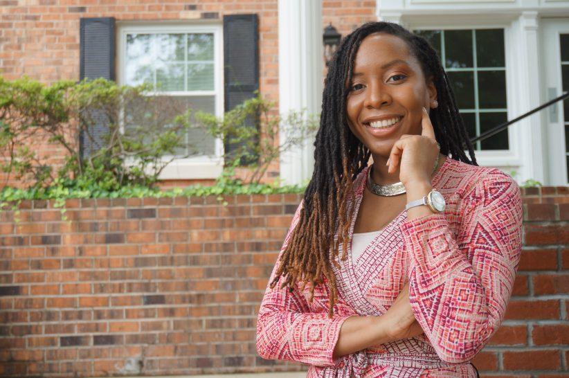 Malika Grayson outdoors in professional attire