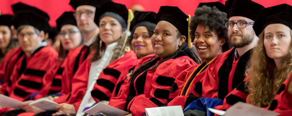 Doctoral program graduates at the Ph.D. hooding ceremony