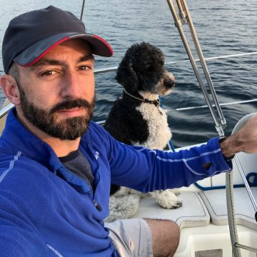 Jason Kahabka on his boat with dog, Archer