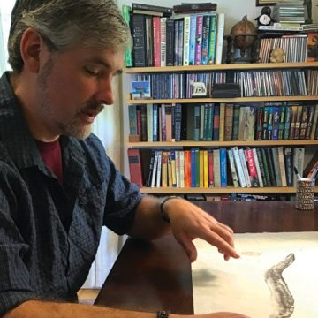 John Wyatt Greenlee with a drawing of an eel