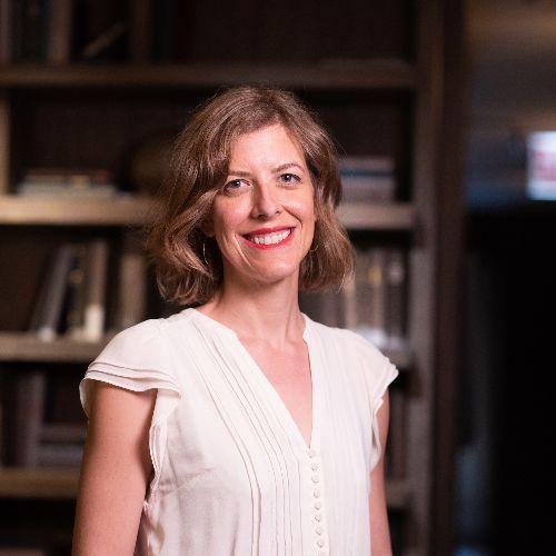 Erin Furtak, University of Colorado at Boulder, smiling in front of bookshelves