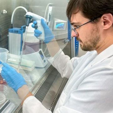 Julius Judd conducting research in a lab